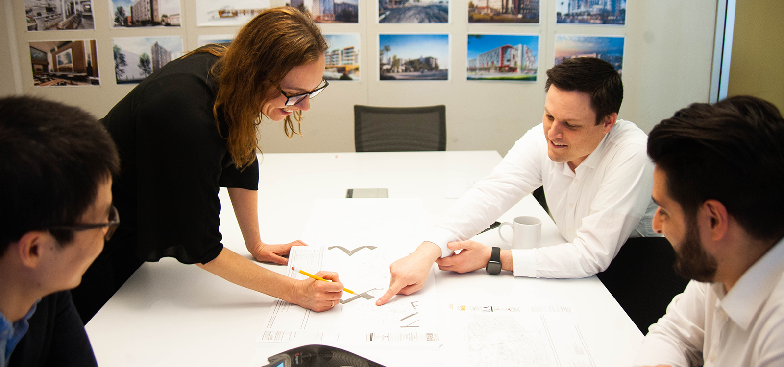 Two team members of California architect and hotel designers AXIS/GFA work on a design.