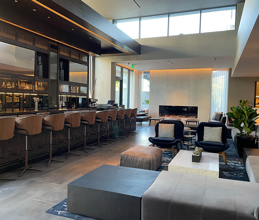 The lobby bar and lounge of the dual-brand hotel AC Hotel Palo Alto, designed by California hotel architect AXIS/GFA Architecture + Design